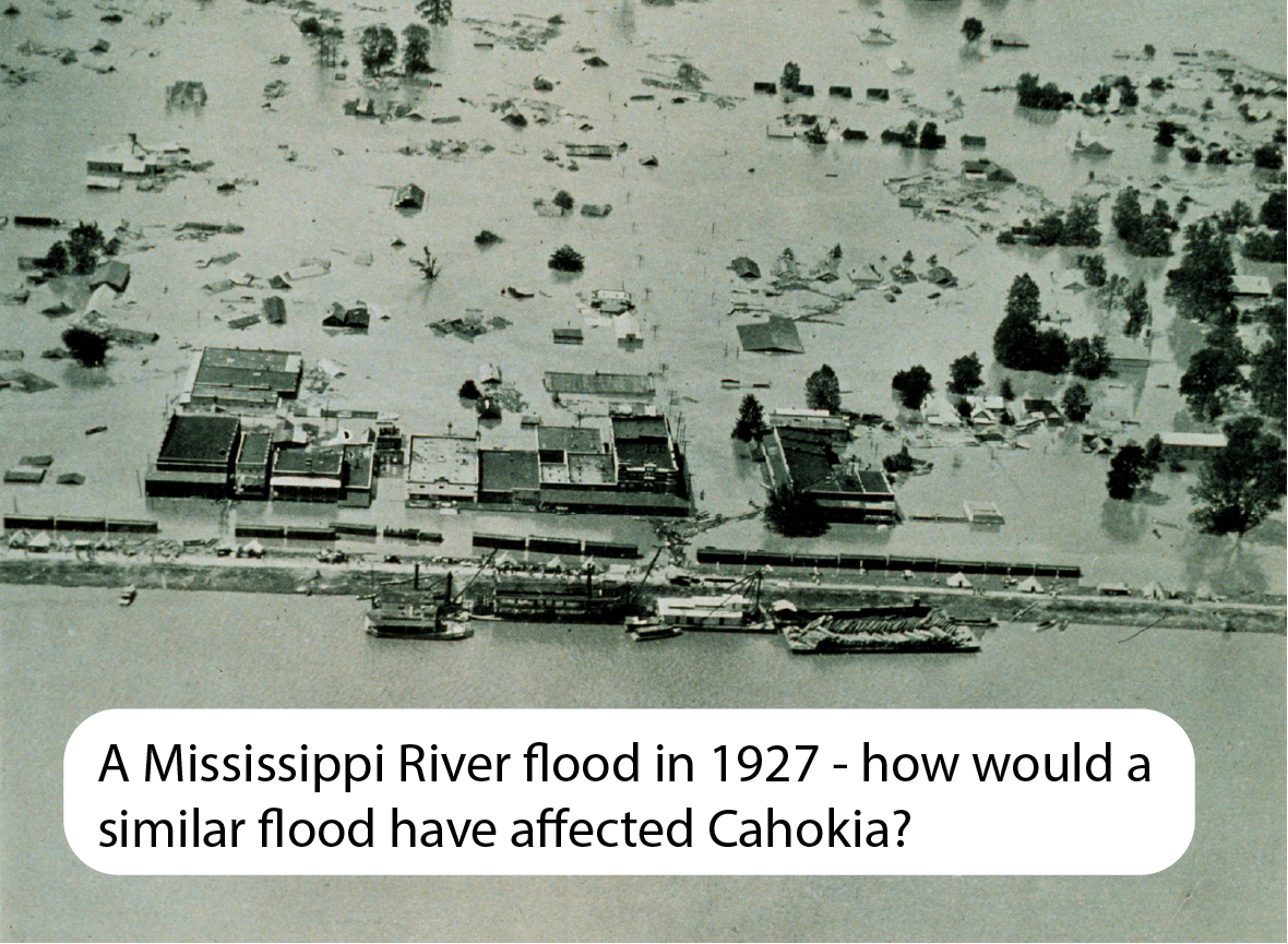 tops of buildings and trees visible above extensive floodwaters