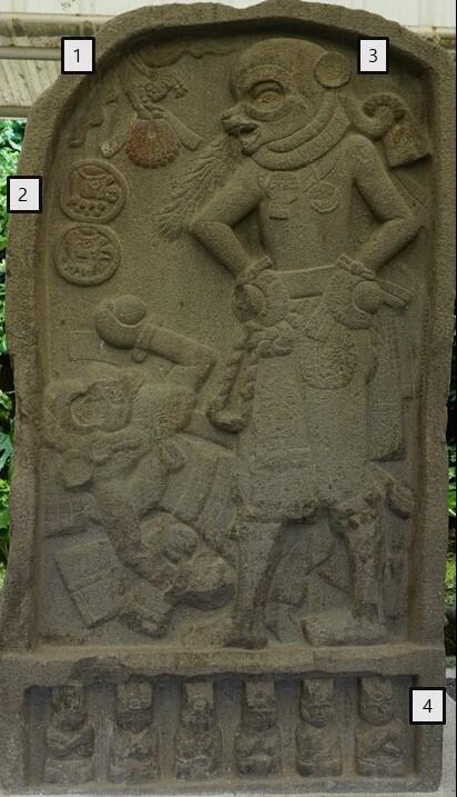 bas-relief stone carving, standing figure with hands on hips, second figure on the ground