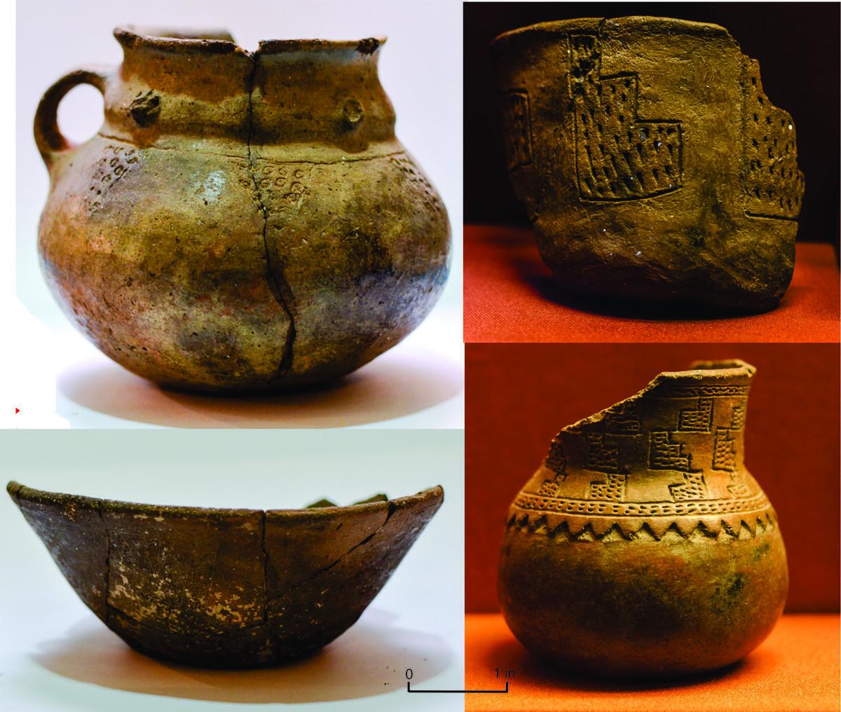 four ceramic vessels featuring embossed designs