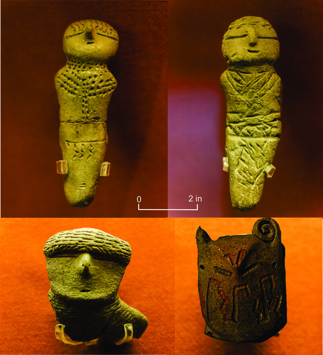 four ceramic figurines, eyes horizontal slits, pointed noses, embossed designs