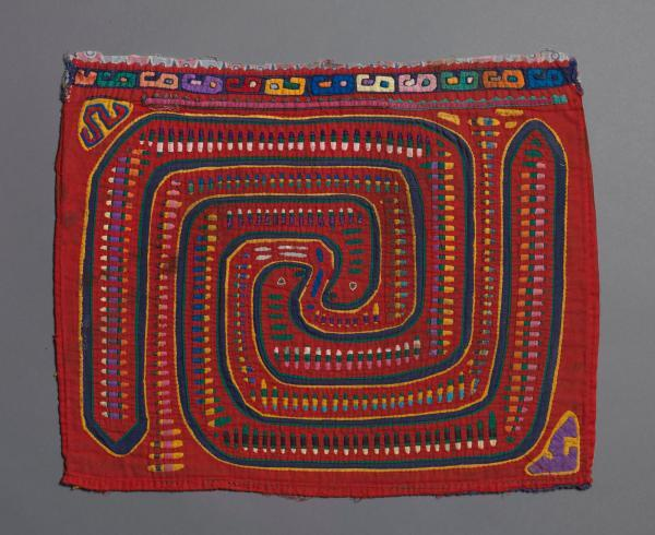 multicolored textile with geometric design in similar shape to carved stone, known as La Mola