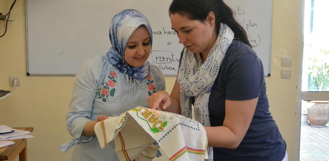 American and Morrocan teacher work together