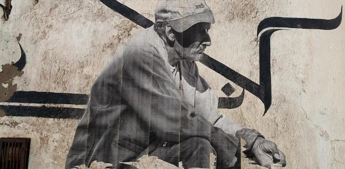 mural of man on stairs, Morocco