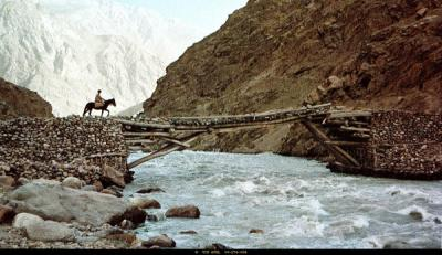 image of man and camel crossing bridge in Afghanistan